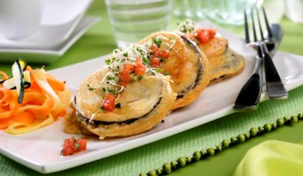 Berenjenas rellenas de jamón y queso, también de aperitivo